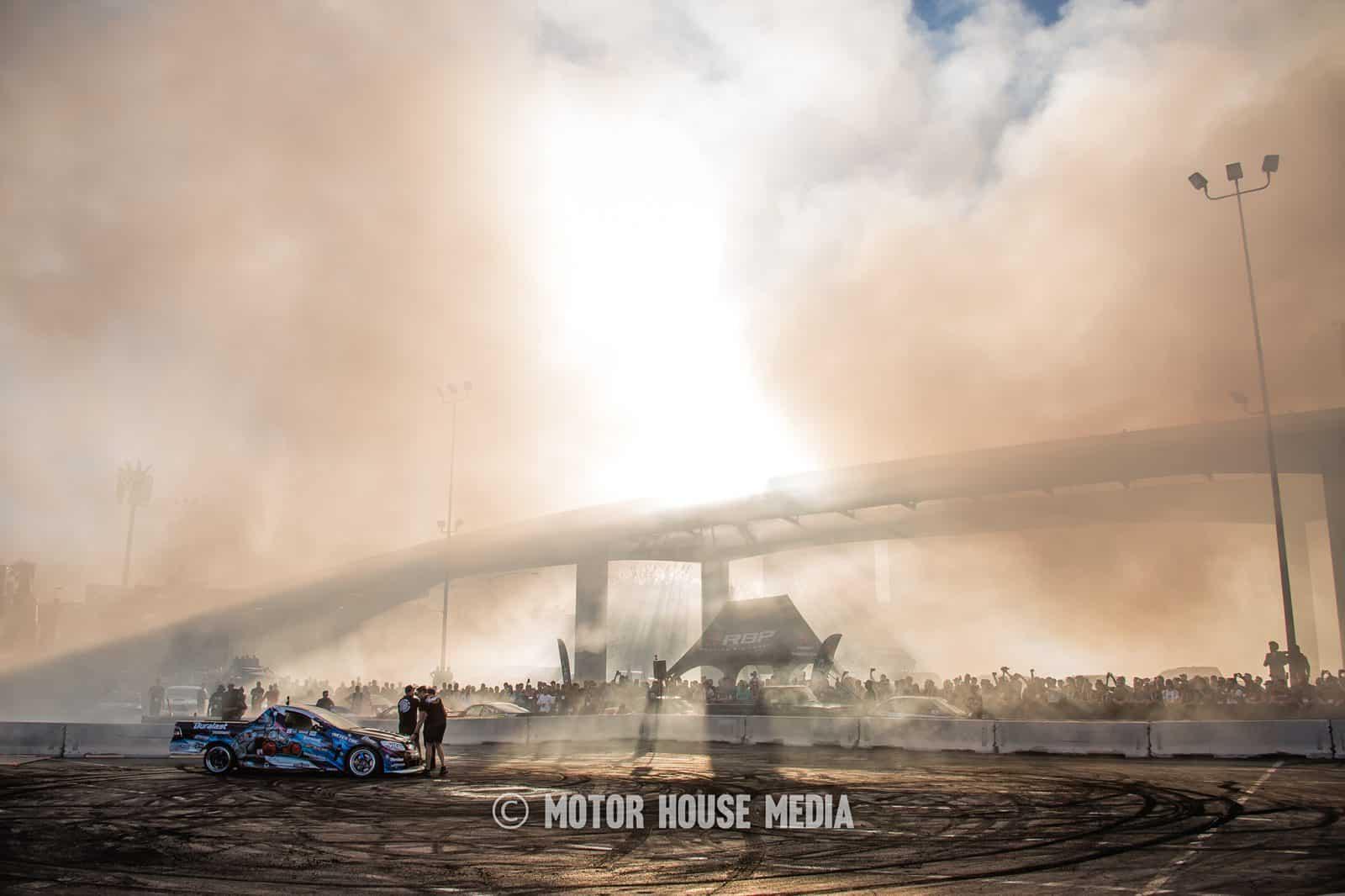 Josh Robinson leaves a cloud of tire smoke at Hoonigan Burnyard