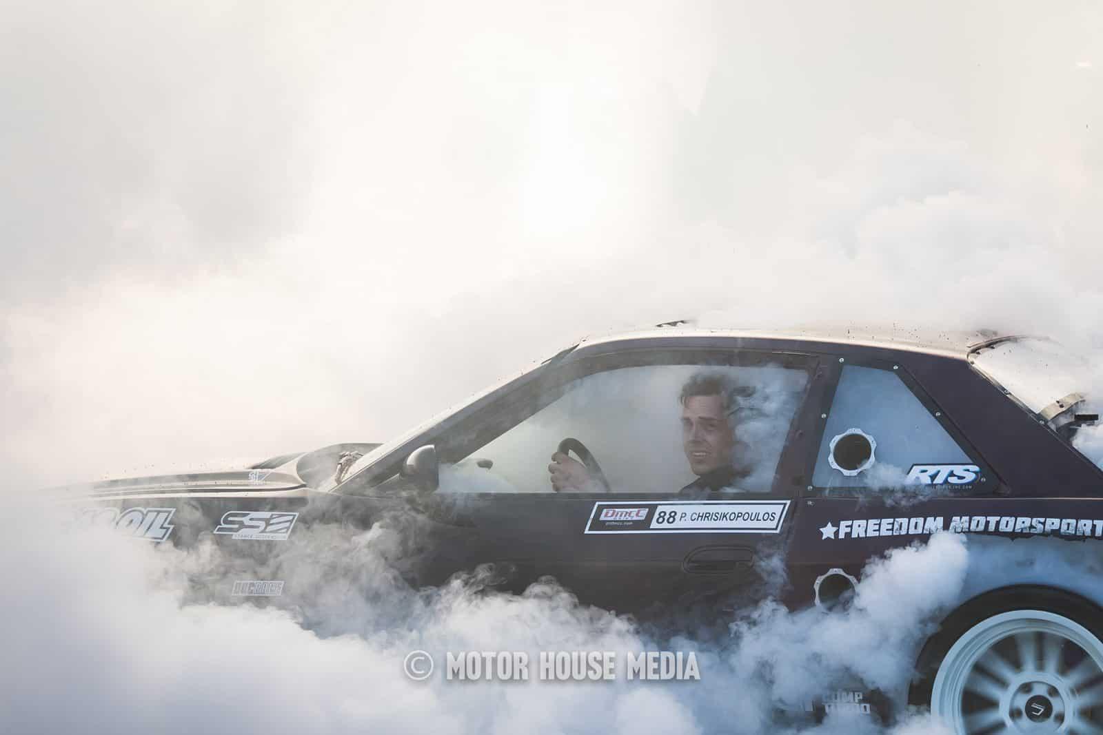 Peter Chrisikopoulos disappearing in tire smoke at the Hoonigan Sema Barnyard