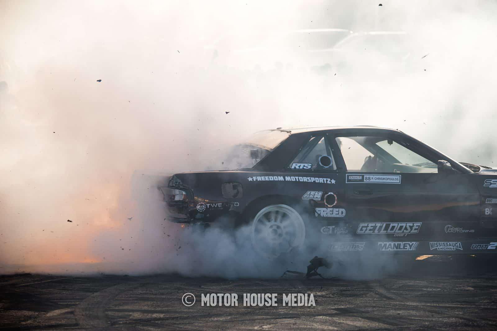 Peter Chrisikopoulos shreds his tires at the Hoonigan Sema Barnyard
