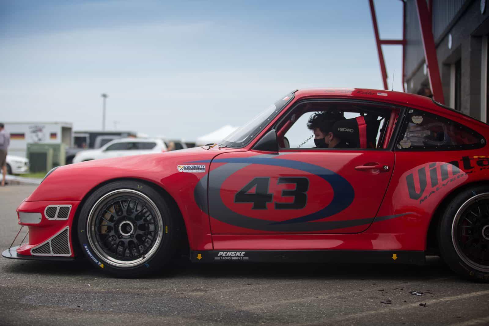 Porsche leaving the paddock