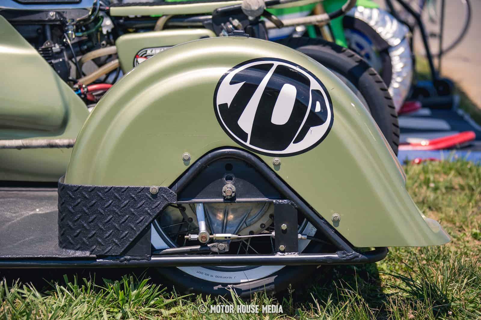 AHRMA vintage Sidecar bikes competing on track