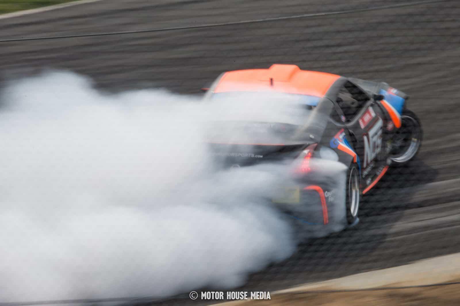 Formula Drift's Chris Forsberg lost in the tire haze